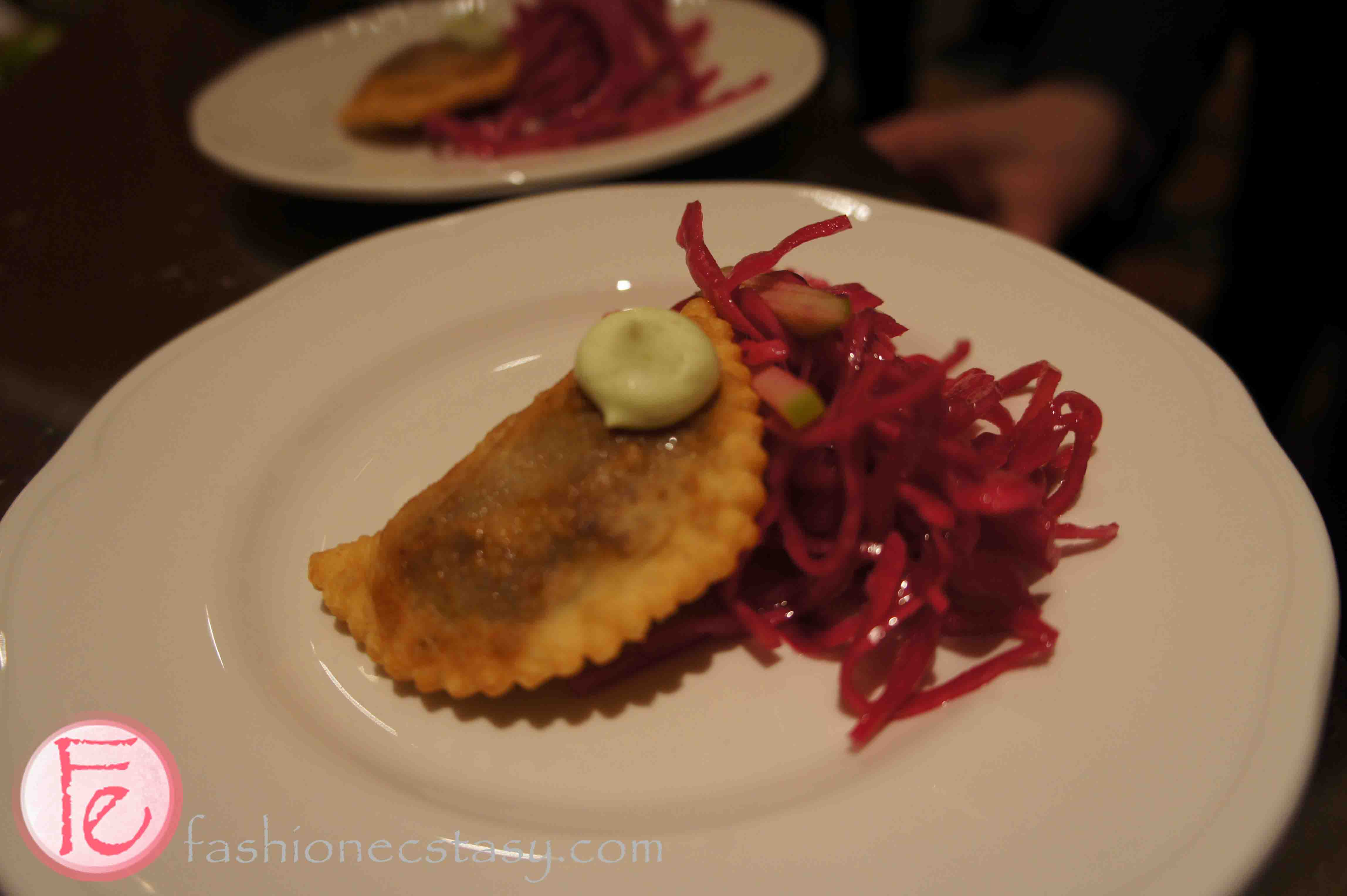 braised lamb empanadas, mini aiolo with pickled red cabbage slaw by Salt