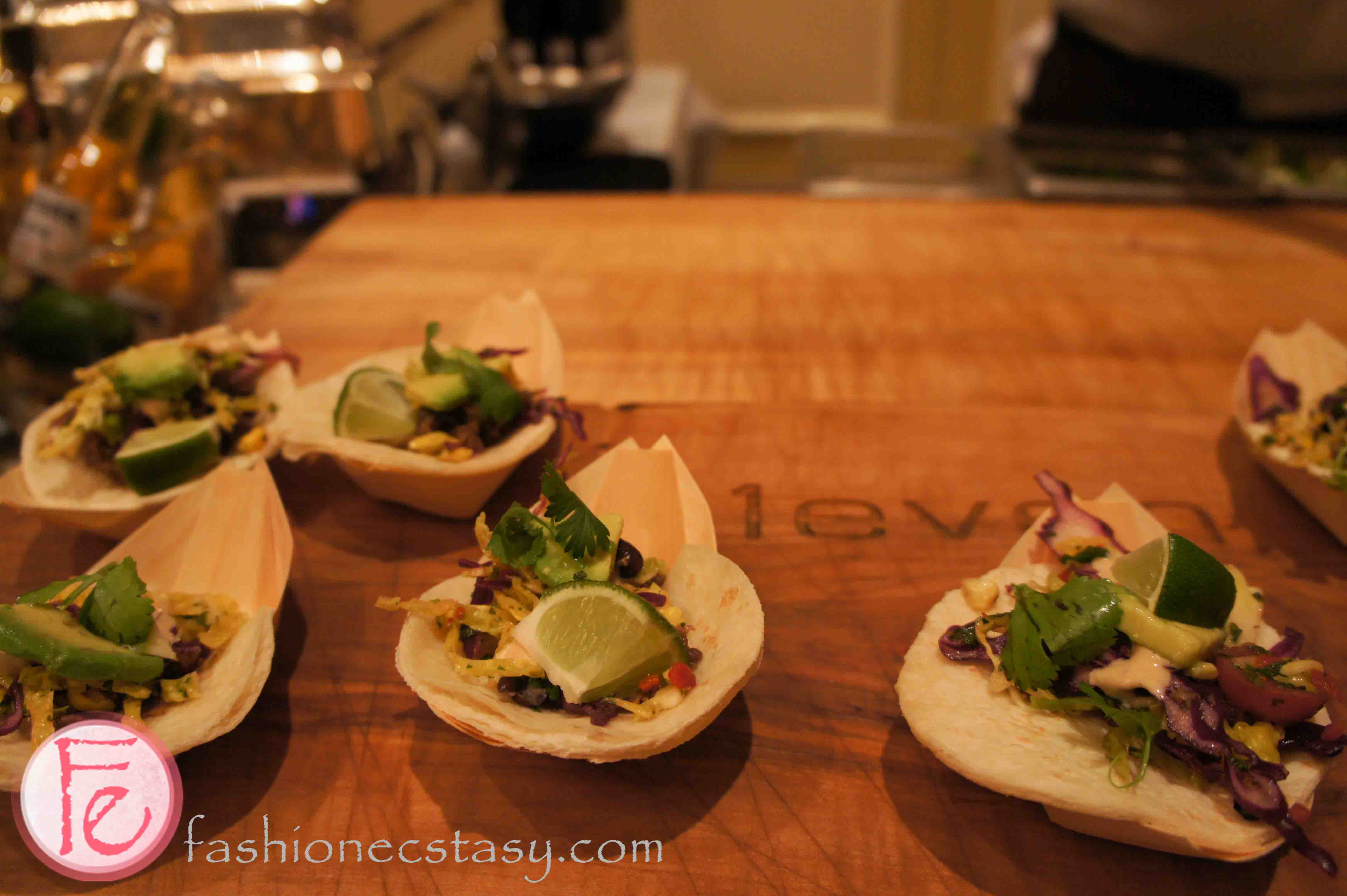 braised lamb shoulder taco prepared with mesquite aioli, advocado, and cilantro by executive Chef Graham Pelley, e11even