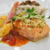 Duo Fish- Sable & Rosenfeld lemon olive tapenade crusted halibut and shrimp crusted salmon on a jasmine rice pilaf with baby zucchini sauteed snow pea leaves and three pepper coulis