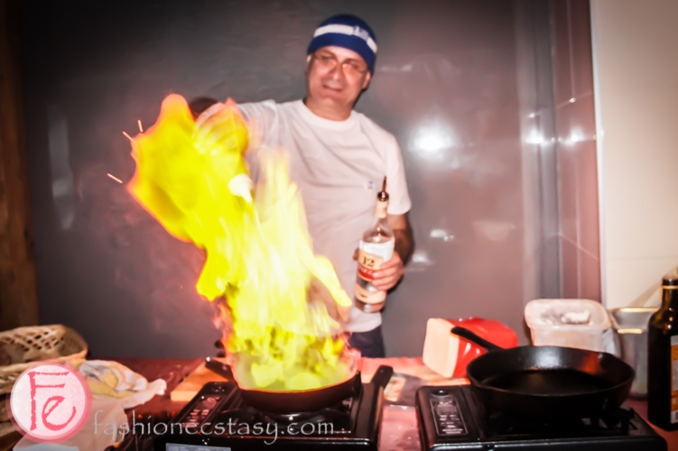 flaming cheese saganaki with honey lemon ouzo sauce by Kalofagas